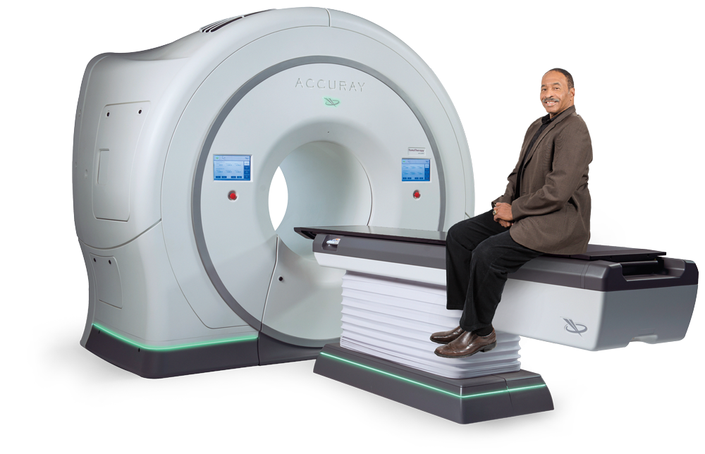 Image of a patient sitting on the TomoTherapy system from Accuray